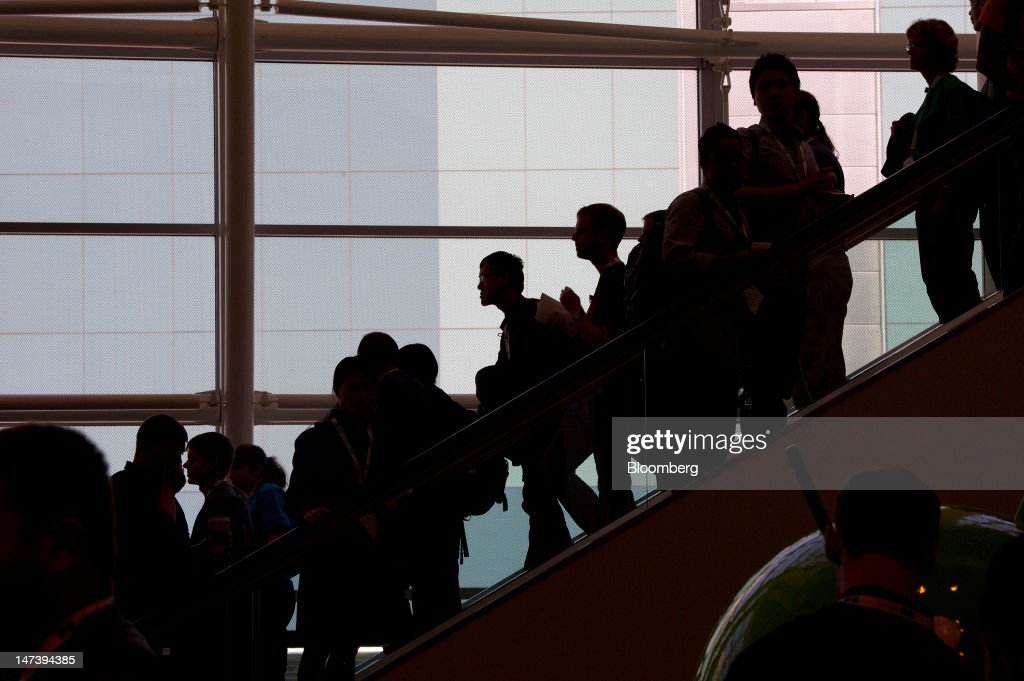 Attendees travel between floors during the Google I/O conference in San Francisco, California, U.S., on Thursday, June 28, 2012. Google Inc., owner of the world's most popular search engine, unveiled a cloud-computing service for building and running applications to help woo customers and challenge Amazon.com Inc.'s Web Services. Photographer: David Paul Morris/Bloomberg via Getty Images