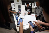 Attendees try Fujitsu Ltd Arrows smartphones during a news conference unveiling NTT Docomo Inc's new smartphone models in Tokyo Japan on Tuesday Sept...
