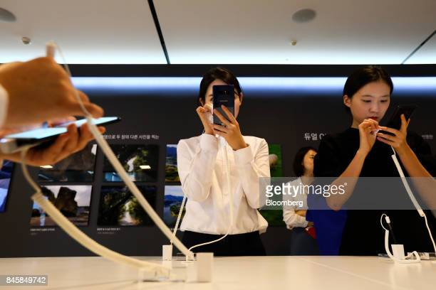 Attendees try out Samsung Electronics Co Galaxy Note 8 smartphones during a media event in Seoul South Korea on Tuesday Sept 12 2017 Samsung's...