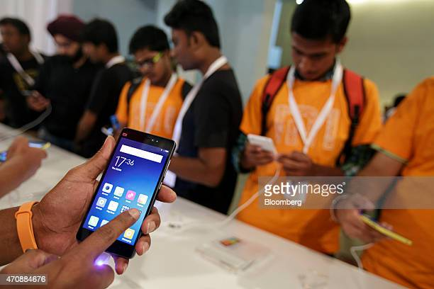 Attendees try out the Xiaomi Corp Mi 4i smartphone during a launch event in New Delhi India on Thursday April 23 2015 Xiaomi unveiled the...