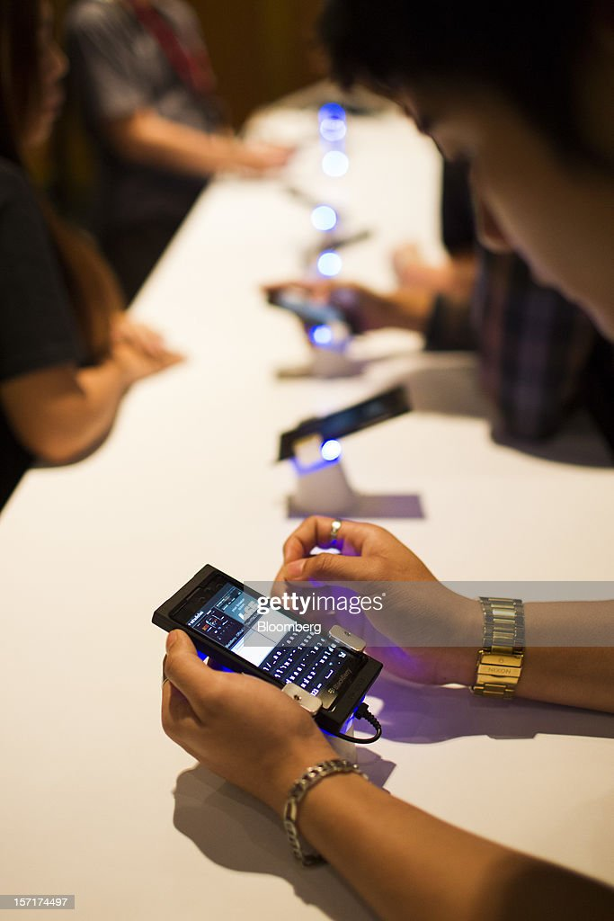 Attendees try Research In Motion Ltd. (RIM) BlackBerry 10 smartphone prototypes at the BlackBerry Jam Asia developer conference in Bangkok, Thailand, on Thursday, Nov. 29, 2012. RIM gained after Goldman Sachs Group Inc. upgraded the stock to buy, saying the new BlackBerry 10 phones could help it return to profitability in fiscal 2014. Photographer: Brent Lewin/Bloomberg via Getty Images