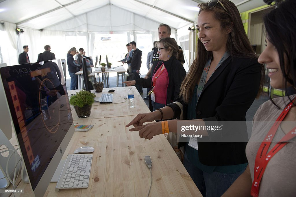 Attendees try the new Leap Motion Controller made by Leap Motion at the South By Southwest Conference (SXSW) in Austin, Texas, U.S., on Monday, March 11, 2013. The 20th annual SXSW Interactive Festival takes place from March 8-12. Photographer: David Paul Morris/Bloomberg via Getty Images