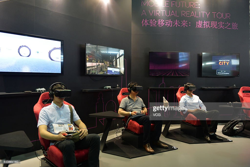 Attendees try virtual reality (VR) game during the Mobile World Congress Shanghai at Shanghai New International Expo Centre on June 30, 2016 in Shanghai, China. The Mobile World Congress Shanghai 2016 opens from June 29 to July 1.