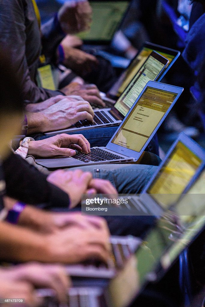 Attendees type on laptop computers during the Facebook F8 Developers Conference in San Francisco, California, U.S., on Wednesday, April 30, 2014. Facebook Inc. will offer software developers improved tools to create programs that run on any smartphone and a more streamlined experience for people to log into apps, including the option to sign in anonymously. Photographer: Erin Lubin/Bloomberg via Getty Images