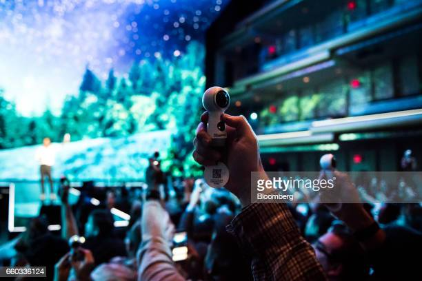 Attendees use Samsung Electronics Co Gear 360 camera during the company's Unpacked product launch event in New York US on Wednesday March 29 2017...