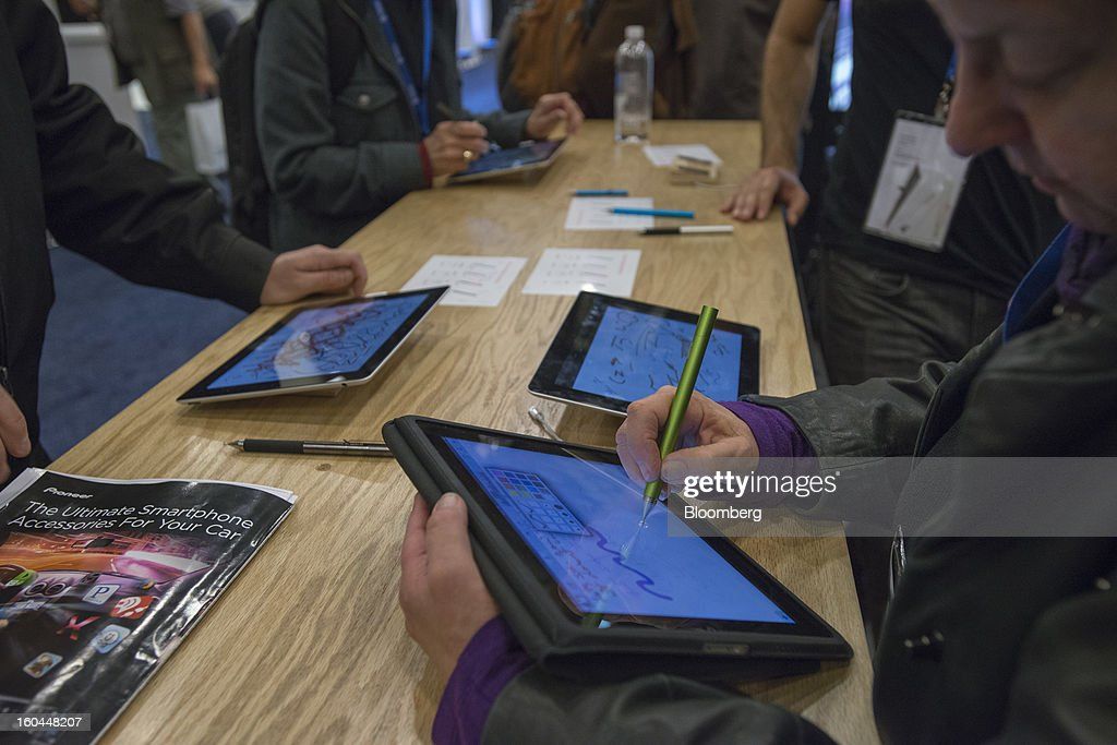 Attendees use the Jot Touch Bluetooth pressure sensitive stylus with Apple Inc. iPads at the Macworld/iWorld conference at the Moscone Center West in San Francisco, California, U.S., on Thursday, Jan. 31, 2013. This year's conference, titled 'The Ultimate iFANEvent,' brings together attendees to celebrate Apple Inc. technology and learn more about products and services for Apple users. Photographer: David Paul Morris/Bloomberg via Getty Images