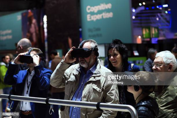 Attendees use Virtual Reality headsets at the CeBIT 2017 tech fair in Hannover Germany on Tuesday March 21 2017 Leading edge technologies in the...