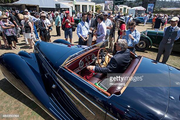 Attendees view 1939 Bugatti Automobiles SAS Type 57C Vanvooren Cabriolet vehicle during the 2015 Pebble Beach Concours d'Elegance in Pebble Beach...