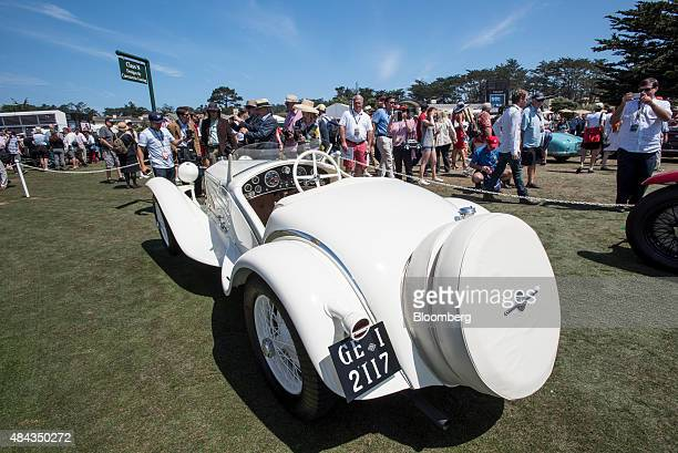 Attendees view a 1031 Alfa Romeo Automobiles SpA 6C 1750 Gran Sport Touring 'Flying Star' Spider vehicle during the 2015 Pebble Beach Concours...