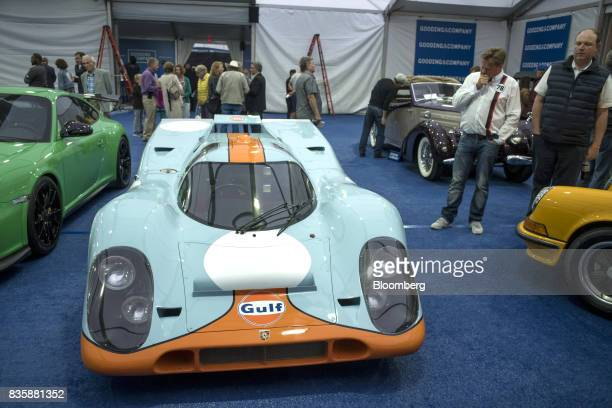 Attendees view a 1970 Porsche AG 917k race vehicle formerly driven by actor Steve McQueen in the movie 'Le Mans' at the Gooding and Company auction...