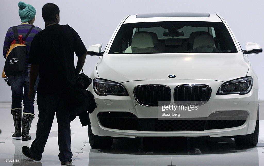 Attendees view a 2013 Bayerische Motoren Werke AG (BMW) 750 Li Sedan vehicle during the LA Auto Show in Los Angeles, California, U.S., on Thursday, Nov. 29, 2012. The LA Auto Show is open to the public Nov. 30 through Dec. 9. Photographer: Jonathan Alcorn/Bloomberg via Getty Images