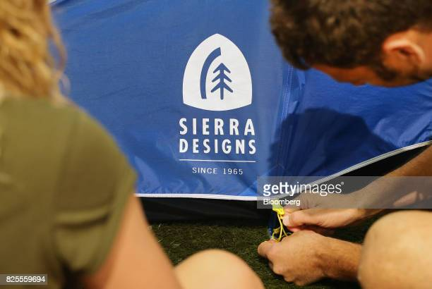 Attendees view a Sierra Designs tent on display during the Outdoor Retailer Summer Market Show in Salt Lake City Utah US on Saturday July 29 2017...