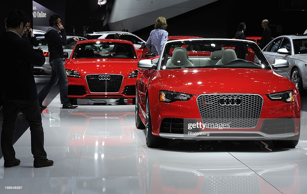 Attendees view Audi AG vehicles during the 2013 North American International Auto Show (NAIAS) in Detroit, Michigan, U.S., on Tuesday, Jan. 15, 2013. The Detroit auto show runs through Jan. 27 and will display over 500 vehicles, representing the most innovative designs in the world. Photographer: David Paul Morris/Bloomberg via Getty Images