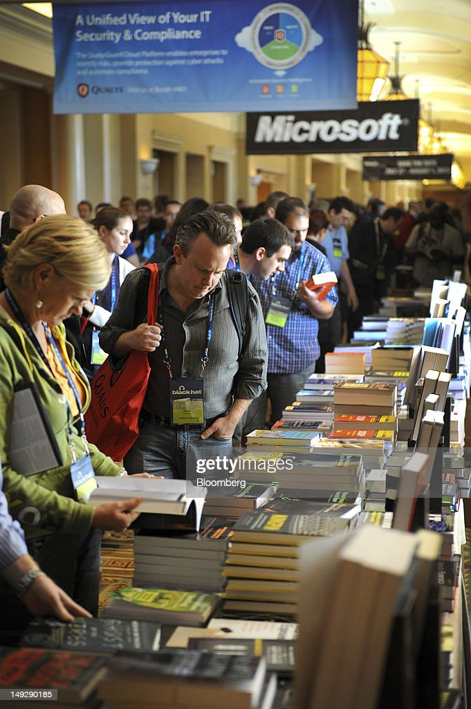 Attendees view books about security technology during the Black Hat USA 2012 conference at Caesar's Palace resort and casino in Las Vegas, Nevada, U.S., on Wednesday, July 25, 2012. The conference brings together leaders from all facets of the information security world, from corporate and government sectors to academic and even underground researchers. Photographer: Jacob Kepler/Bloomberg via Getty Images