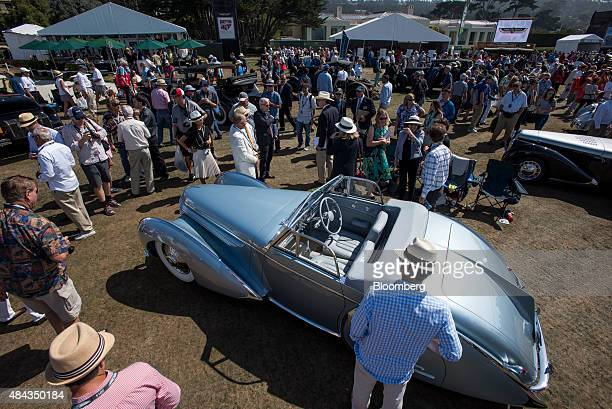 Attendees view cars on display during the 2015 Pebble Beach Concours d'Elegance in Pebble Beach California US on Sunday Aug 16 2015 Of the top 10...