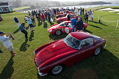 Attendees view Class M2 Ferrari's on display during the 2015 Pebble Beach Concours d'Elegance in Pebble Beach California US on Sunday Aug 16 2015 At...