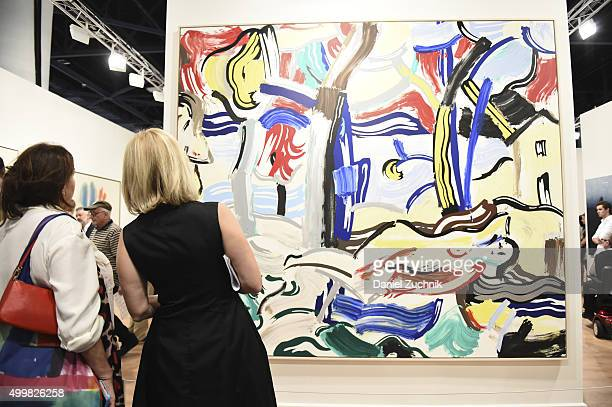 Attendees view 'Figures in Landscape' by artist Roy Lichtenstein at the Art Basel Miami Beach VIP Preview at the Miami Beach Convention Center on...