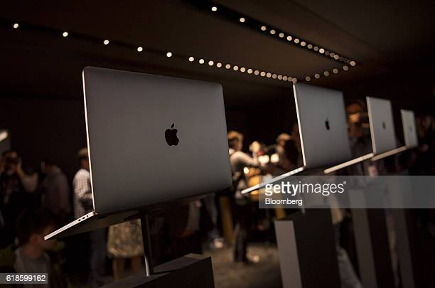 Attendees view new MacBook Pro laptop computers during an event at Apple Inc headquarters in Cupertino California US on Thursday Oct 27 2016 Apple...