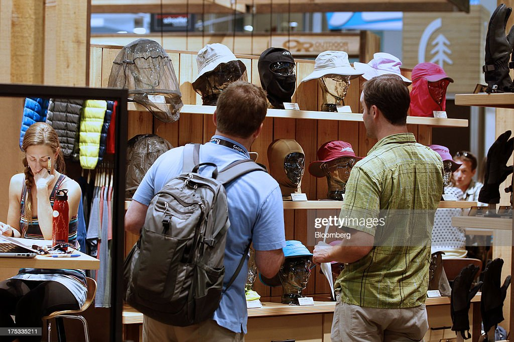 Attendees view Outdoor Research accessories at the company's booth during the Outdoor Retailer Summer Market show in Salt Lake City, Utah, U.S., on Thursday, Aug. 1, 2013. Consumer spending in the U.S. rose in line with forecasts in June as Americans' incomes grew, a sign the biggest part of the economy is withstanding fiscal headwinds. Photographer: George Frey/Bloomberg via Getty Images