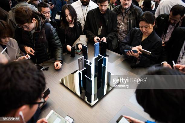 Attendees view Samsung Electronics Co Galaxy S8 smartphones displayed during the Samsung Unpacked product launch event in New York US on Wednesday...