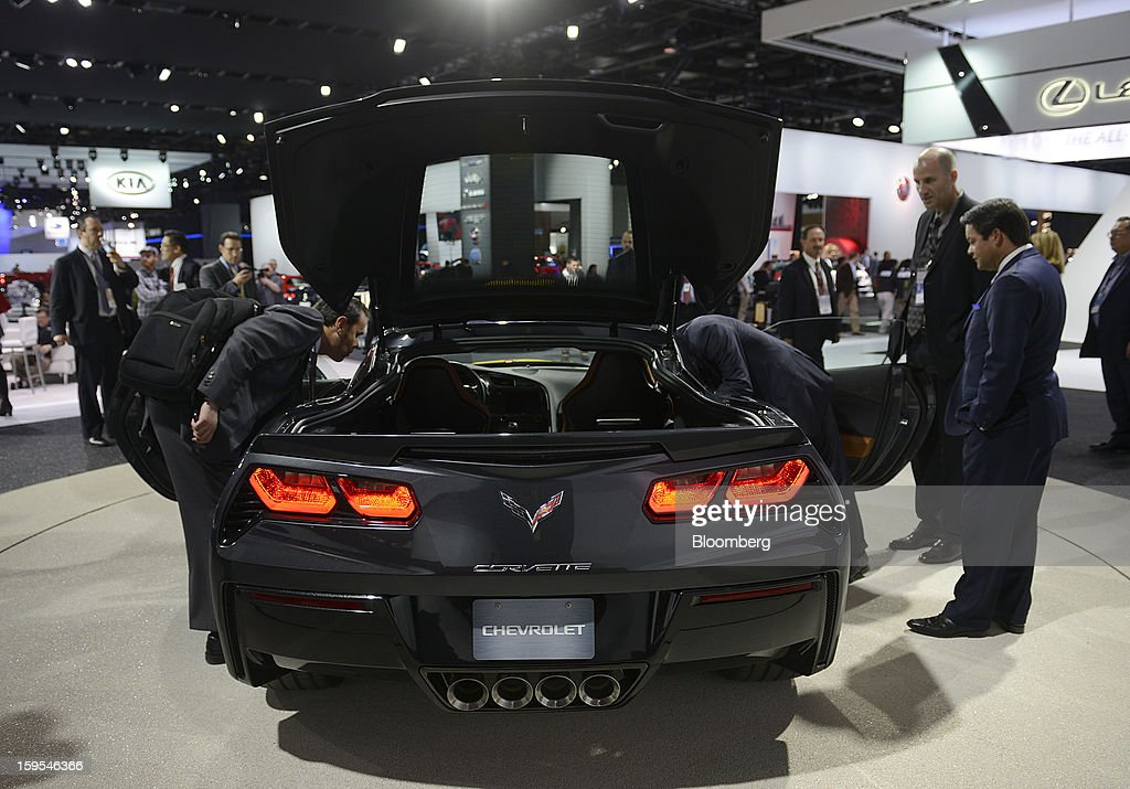 Attendees view the 2014 Chevrolet Corvette Stingray during the 2013 North American International Auto Show (NAIAS) in Detroit, Michigan, U.S., on Tuesday, Jan. 15, 2013. The Detroit auto show runs through Jan. 27 and will display over 500 vehicles, representing the most innovative designs in the world. Photographer: David Paul Morris/Bloomberg via Getty Images