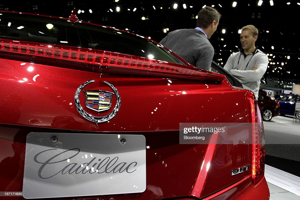 Attendees view the General Motors Co. (GM) Cadillac ATS vehicle displayed at the company's booth during the LA Auto Show in Los Angeles, California, U.S., on Thursday, Nov. 29, 2012. The LA Auto Show is open to the public Nov. 30 through Dec. 9. Photographer: Jonathan Alcorn/Bloomberg via Getty Images