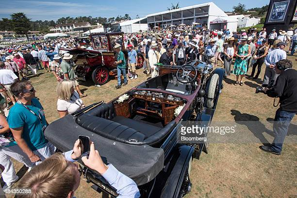 Attendees view the interior of a 1914 RollsRoyce Ltd Silver Ghost Kellner Torpedo Phaeton is seen during the 2015 Pebble Beach Concours d'Elegance in...