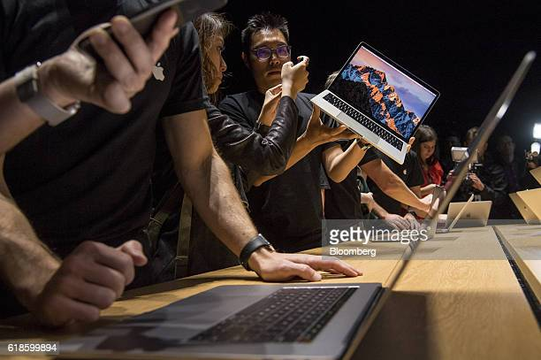 Attendees view the new MacBook Pro laptop computer during an event at Apple Inc headquarters in Cupertino California US on Thursday Oct 27 2016 Apple...