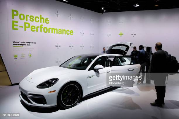 Attendees view the Porsche Automobil Holding SE Panamera Turbo S ehybrid vehicle is displayed during AutoMobility LA ahead of the Los Angeles Auto...