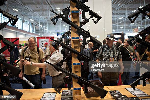 Attendees visit a booth at the 144th National Rifle Association Annual Meetings and Exhibits at the Music City Center in Nashville Tennessee US on...