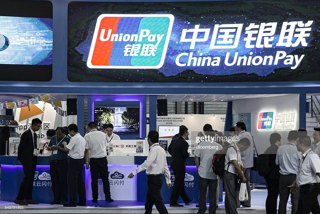 Attendees visit a China UnionPay Co. booth at the Mobile World Congress Shanghai in Shanghai, China, on Thursday, June 30, 2016. The exhibition runs until July 1. Photographer: Qilai Shen/Bloomberg via Getty Images