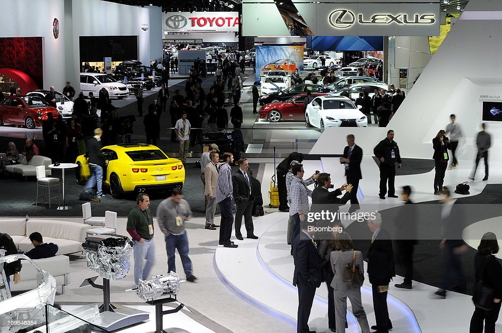 Attendees visit booths during the 2013 North American International Auto Show (NAIAS) in Detroit, Michigan, U.S., on Tuesday, Jan. 15, 2013. The Detroit auto show runs through Jan. 27 and will display over 500 vehicles, representing the most innovative designs in the world. Photographer: David Paul Morris/Bloomberg via Getty Images