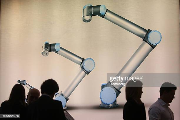Attendees visit the ABB Ltd robotics exhibition trade stand at the Hanover industrial fair in Hanover Germany on Monday April 13 2015 Indian Prime...