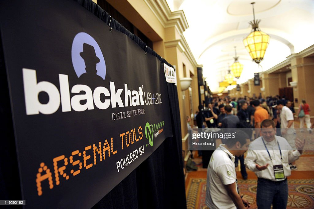 Attendees visit the Arsenal Tools booth during the Black Hat USA 2012 conference at Caesar's Palace resort and casino in Las Vegas, Nevada, U.S., on Wednesday, July 25, 2012. The conference brings together leaders from all facets of the information security world, from corporate and government sectors to academic and even underground researchers. Photographer: Jacob Kepler/Bloomberg via Getty Images