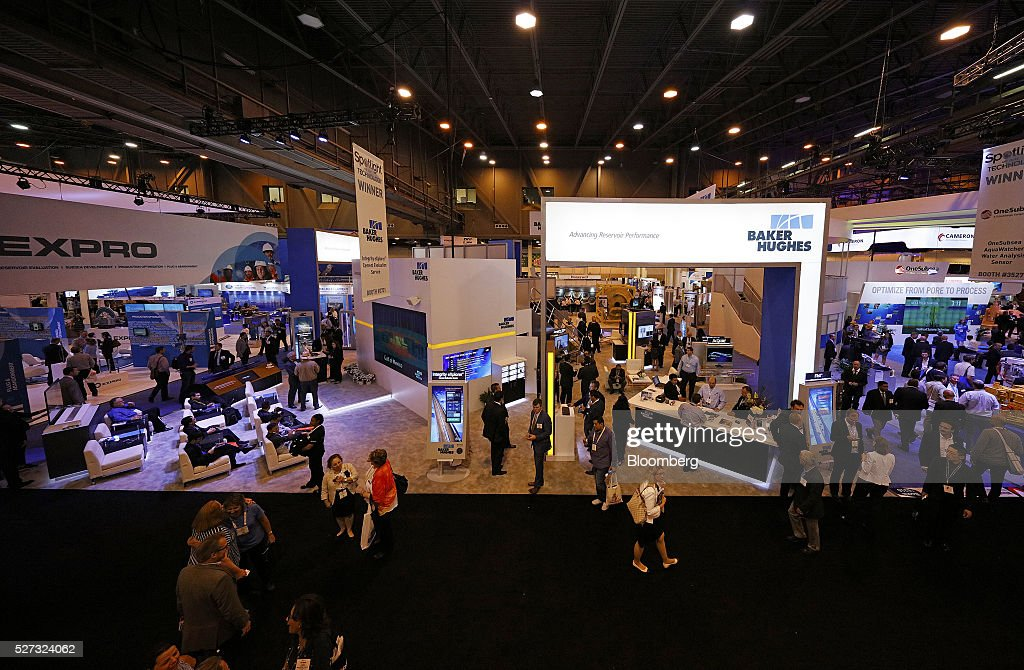 Attendees visit the Baker Hughes Inc. booth during the 2016 Offshore Technology Conference (OTC) in Houston, Texas, U.S., on Monday, May 2, 2016. The OTC gathers energy professionals to exchange ideas and opinions to advance scientific and technical knowledge for offshore resources. Photographer: Aaron M. Sprecher/Bloomberg via Getty Images