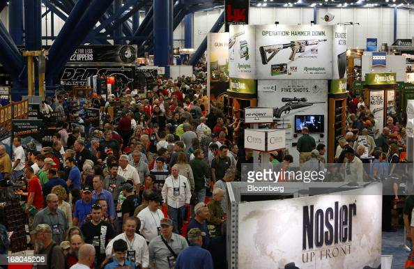 Attendees visit the exhibits during the 2013 National Rifle Association Annual Meetings Exhibits at the George R Brown Convention Center in Houston...