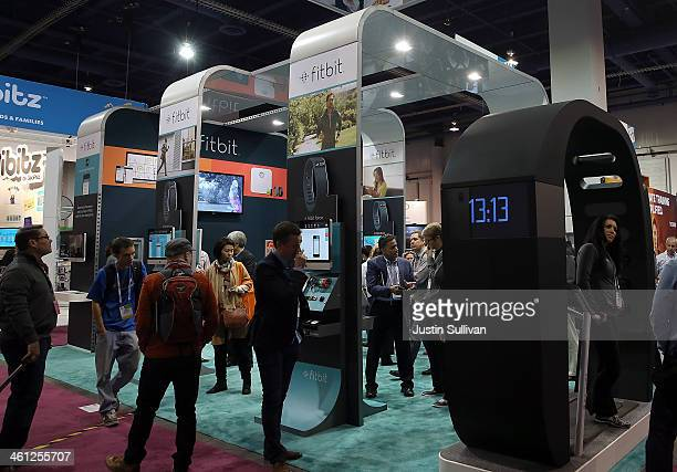 Attendees visit the Fitbit booth at the 2014 International CES at the Las Vegas Convention Center on January 7 2014 in Las Vegas Nevada CES the...