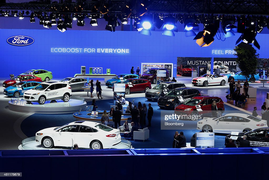 Attendees visit the Ford Motor Co. booth during the LA Auto Show in Los Angeles, California, U.S., on Thursday, Nov. 21, 2013. The 2013 LA Auto Show is open to the public Nov. 22 - Dec. 1. Photographer: Jonathan Alcorn/Bloomberg via Getty Images