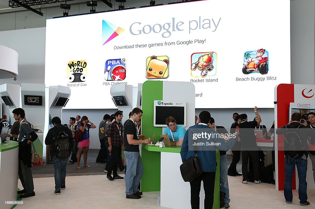 Attendees visit the Google Play booth during the Google I/O developers conference at the Moscone Center on May 15, 2013 in San Francisco, California. Thousands are expected to attend the 2013 Google I/O developers conference that runs through May 17. At the close of the markets today Google shares were at all-time record high at $916 a share, up 3.3 percent.