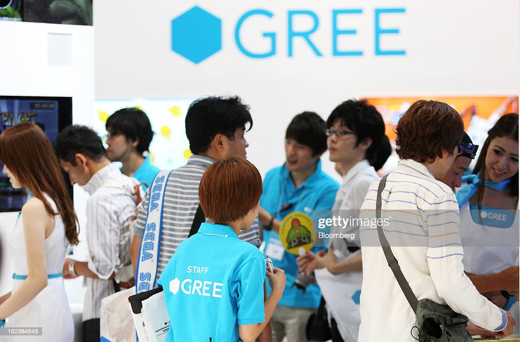 Attendees visit the Gree Inc. booth at the Tokyo Game Show 2012 at Makuhari Messe in Chiba, Japan, on Thursday, Sept. 20, 2012. The show will be held through Sept. 23. Photographer: Tomohiro Ohsumi/Bloomberg via Getty Images