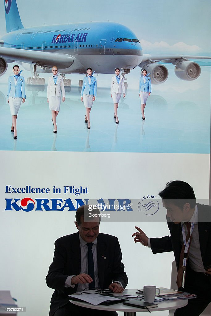 Attendees visit the Korean Air Lines Co. stand at the ITB Berlin tourism fair at Messe Berlin exhibition center in Berlin, Germany, on Wednesday, March 5, 2014. Archaic rules, taxes as high as those imposed on alcohol and an infrastructure deficit, especially in Asia, are curbing the aviation industry's growth, the International Air Transport Association said. Photographer: Krisztian Bocsi/Bloomberg via Getty Images