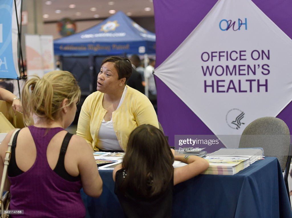Attendees visit the Office On Women's Health booth at FAN FEST during the 2016 BET Experience on June 25, 2016 in Los Angeles, California.