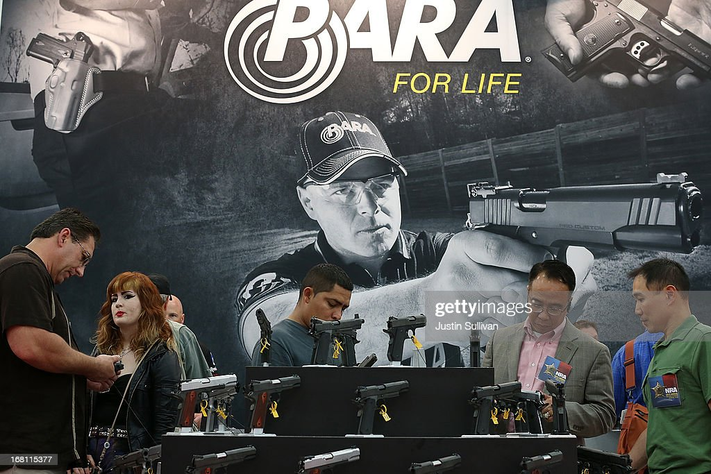Attendees visit the Para booth during the 2013 NRA Annual Meeting and Exhibits at the George R. Brown Convention Center on May 5, 2013 in Houston, Texas. More than 70,000 people attended the NRA's 3-day annual meeting that featured nearly 550 exhibitors, a gun trade show and a political rally.