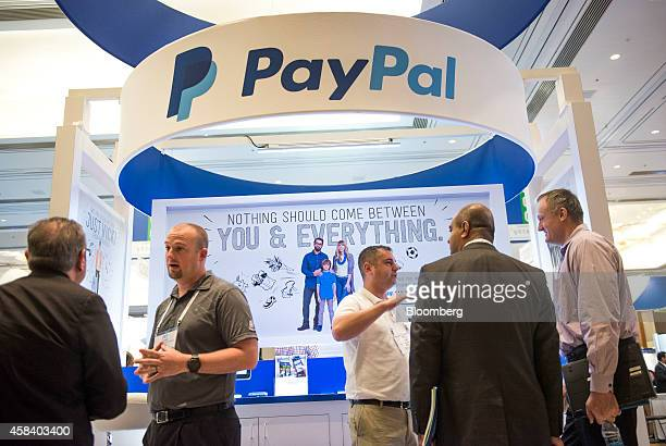 Attendees visit the PayPal booth at the Money 20/20 conference in Las Vegas Nevada US on Tuesday Nov 4 2014 The conference which includes over 100...