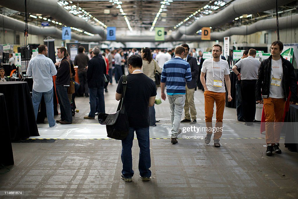 Attendees visit various booths at the TechCrunch Disrupt NYC 2011 conference in New York, U.S., on Tuesday, May 24, 2011. The summit brings together leaders from various tech fields to discuss how the internet is disrupting industry after industry, from media and social commerce to payments and transportation. Photographer: Guy Calaf/Bloomberg via Getty Images