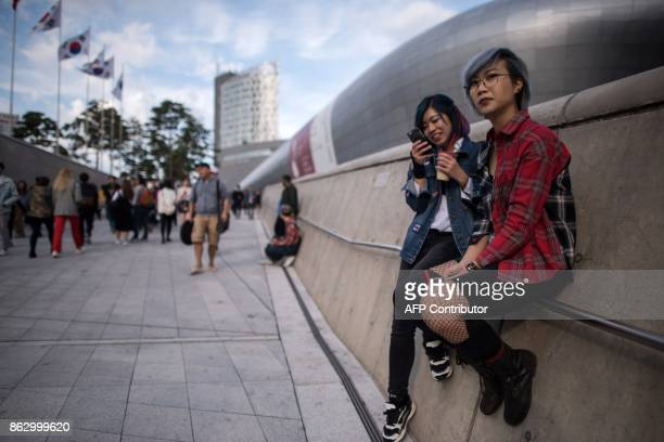 Attendees wait for a show during Seoul Fashion Week at Dongdaemun Design Plaza in Seoul on October 19 2017 For Seoul's flamboyant followers of...