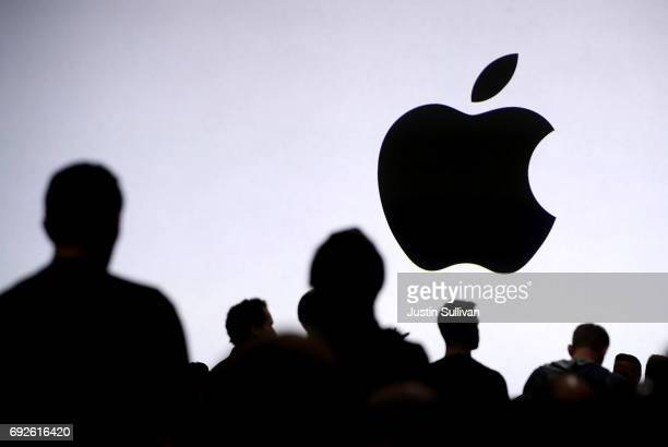 Attendees wait for the start of the 2017 Apple Worldwide Developer Conference at the San Jose Convention Center on June 5 2017 in San Jose California...