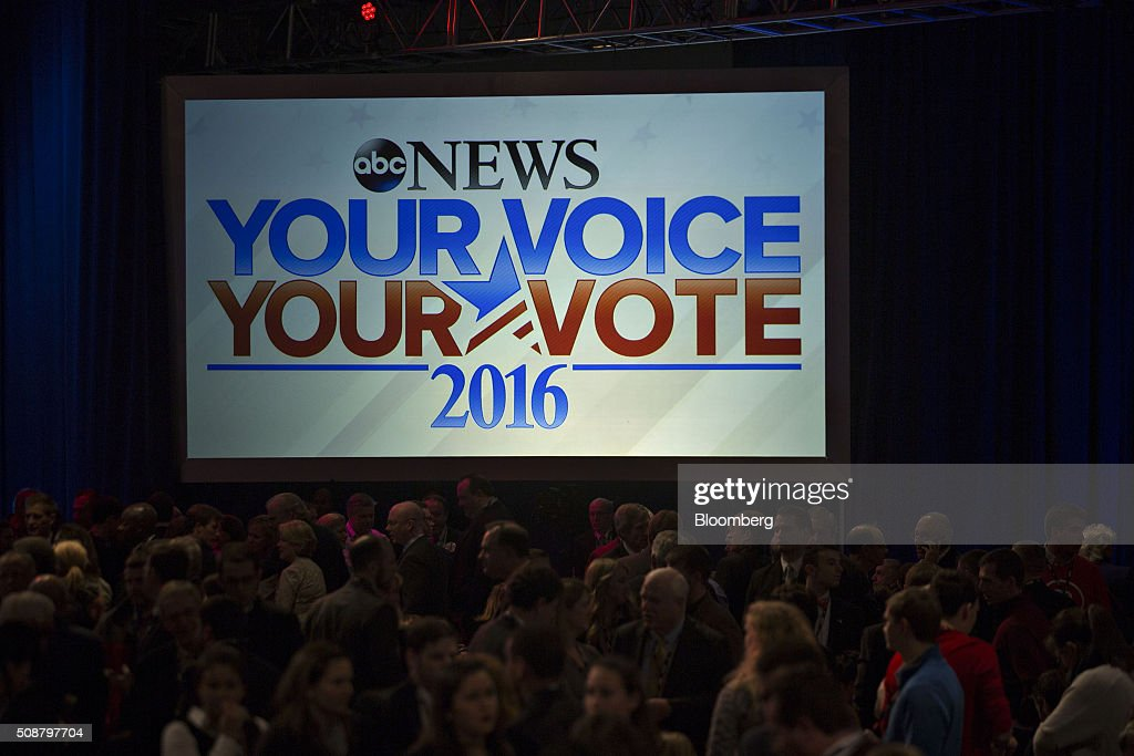 Attendees wait for the start of the Republican presidential candidate debate sponsored by ABC News and the Independent Journal Review at Saint Anselm College in Manchester, New Hampshire, U.S., on Saturday, Feb. 6, 2016. The candidates are battling for next weeks primary in New Hampshire after Trump, the billionaire real estate developer and reality television star, finished second in the Iowa caucus on Feb. 1, behind Texas Senator Ted Cruz. Photographer: Andrew Harrer/Bloomberg via Getty Images