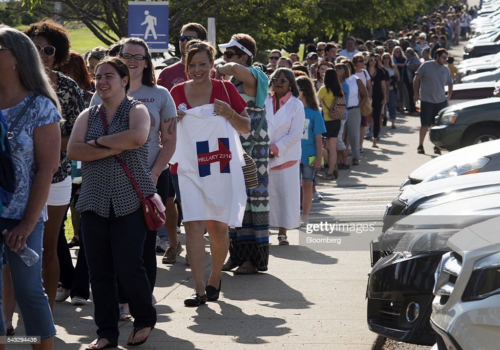 Attendees wait in line for a campaign event with Hillary Clinton, former Secretary of State and presumptive Democratic presidential nominee, not pictured, in Cincinnati, Ohio, U.S., on Monday, June 27, 2016. Clinton released a new national television ad on Sunday attacking likely Republican rival Donald Trump for his comments on the U.K's decision to leave the European Union, and later warned of the negative impact that 'bombastic' behavior can have at times of crisis. Photographer: Ty Wright/Bloomberg via Getty Images