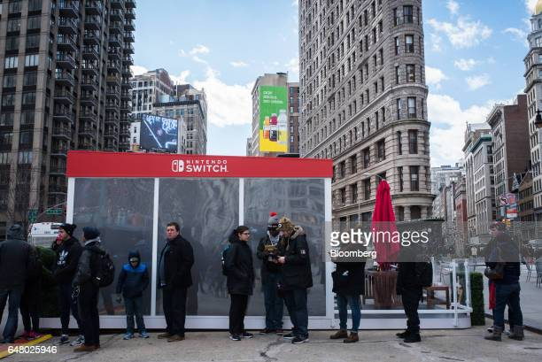 Attendees wait in line to test the Nintendo Co Switch game console during the company's launch event in New York US on Friday March 3 2017 Nintendo...